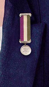 Medallon tricolor feminista
